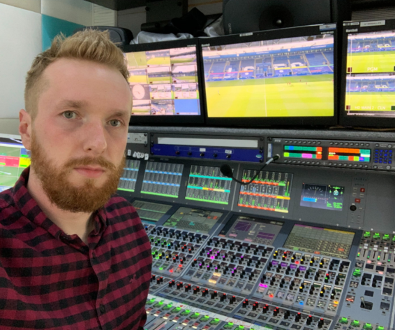 Freelance A1, Sound Supervisor and Sound Guarantee, Chris Eckford in front of a Calrec Apollo audio console.